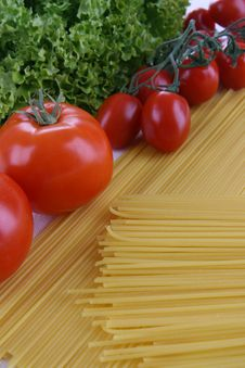 Pasta, Tomatoes And Lettuce Stock Photos