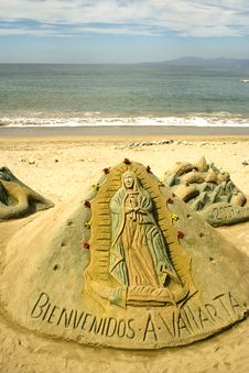 Virgen Of Guadalupe Sculpted In Sand Stock Photo