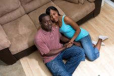 Free Happy Couple Sitting In Front Of Couch - Horizon Stock Photography - 5433372