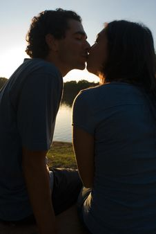 Free Couple Kissing At Sunset-Vertical Stock Photos - 5433373