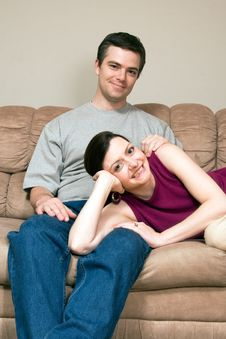 Free Happy Couple Sitting On A Couch - Vertical Royalty Free Stock Photos - 5433398