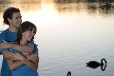 Free Happy Couple Embracing By A Pond - Horizontal Royalty Free Stock Photo - 5433515
