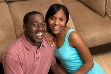 Free Happy Couple Sitting In Front Of Couch - Close U Stock Photo - 5433620