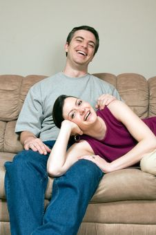 Free Happy, Laughing Couple Sitting On Couch - Vertic Royalty Free Stock Photo - 5433645