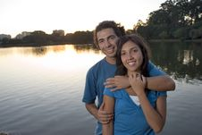 Free Couple Embracing By A Pond - Horizontal Stock Images - 5433684