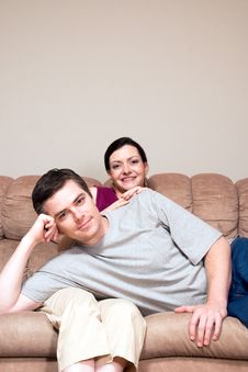 Free Happy, Couple Sitting On A Couch - Vertical Stock Photos - 5433943