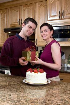 Free Happy Couple In The Kitchen - Vertical Royalty Free Stock Image - 5433956