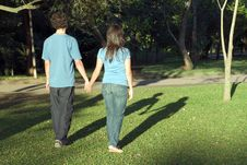 Couple Walking Through Park-Close Up - Horizontal Royalty Free Stock Image