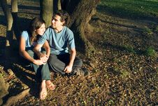 Free Couple Sitting In The Woods - Horizontal Royalty Free Stock Photo - 5434085