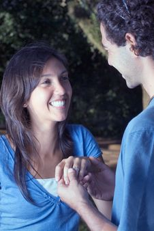 Free Smiling Couple Holding Hands. Close Up - Vertical Stock Photos - 5434113