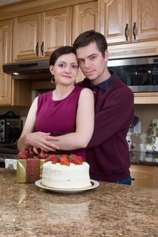 Free Happy Couple In The Kitchen - Vertical Royalty Free Stock Images - 5434219