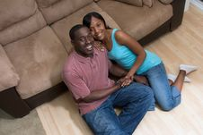 Free Happy Couple Sitting In Front Of Couch-Horizontal Royalty Free Stock Image - 5434226