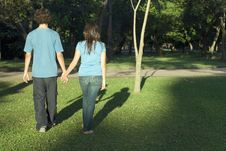 Free Couple Holding Hands In A Park - Horizontal Stock Photography - 5434242