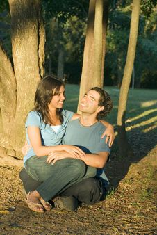 Free Happy Couple Sitting In The Woods. Vertical Stock Photography - 5434272