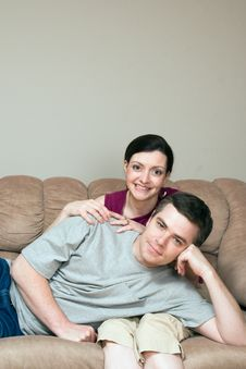 Free Happy, Couple Sitting On A Couch - Vertical Royalty Free Stock Photos - 5434298