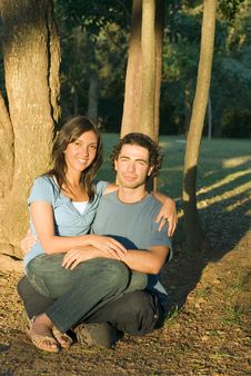 Couple Sitting In The Woods - Vertical Royalty Free Stock Image