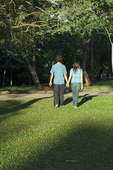 Free Young Couple Walking Through A Park - Vertical Stock Photography - 5434322
