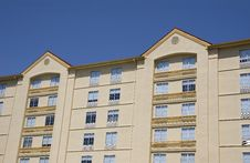 Free Yellow Stucco Hotel On Blue Sky Royalty Free Stock Photography - 5437067