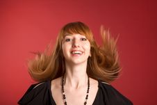 Free Beautiful Red-haired Girl Shaking Her Hair Stock Photo - 5440230
