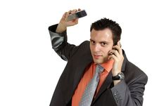 Free Man Stressed With Two Phones Stock Photo - 5441500