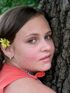 Teenage Girl With Flower By Tree Royalty Free Stock Images