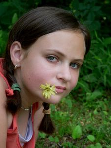 Free Teenage Girl Flower In Mouth Stock Photo - 5442240