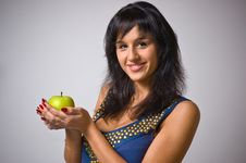 Free The Brunette With A Green Apple Royalty Free Stock Image - 5443376