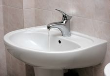 Open Modern Water Faucet And Basin Stock Image