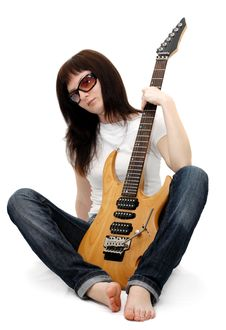 Free Pretty Young Girl Holding An Electric Guitar Stock Photo - 5446820
