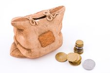 Free A Piggy Bank And Some Coins Stock Photo - 5447970