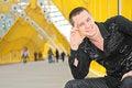 Free Smiling Guy Sits On Footbridge Royalty Free Stock Photo - 5451755