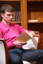 Free Young Man Reads Book Stock Photo - 5453110