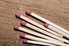 Free Matches On Wooden Surface. Royalty Free Stock Photos - 5450268