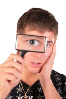 Free Young Man Looks Through Magnifier Royalty Free Stock Photos - 5450808