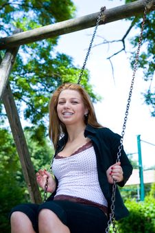 Portrait Of The Young Girl On A Swing Stock Image