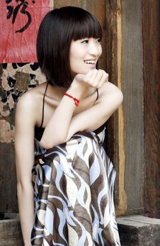 Chinese Girl By The Door Stock Photography