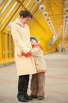 Free Son Embraces Mother On Footbridge Royalty Free Stock Photography - 5451647