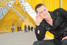Free Smiling Guy Sits On Footbridge Royalty Free Stock Photo - 5451755