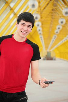 Free Young Man With Cell Phone On Footbridge Stock Images - 5451784