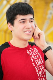 Young Man Talks By  Cell Phone On Footbridg Stock Images