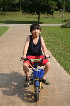 Free Boy Cycling & Whistling Royalty Free Stock Images - 5451939