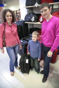 Free Family Buys Suitcase In Shop Royalty Free Stock Photography - 5453267