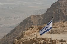 Free Israeli Flag On A Desert Mountain(Masada) Royalty Free Stock Photography - 5453347