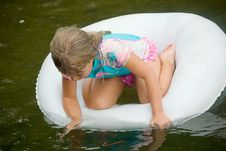 Free Girl In A Tube On The Water Stock Images - 5454094