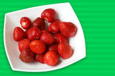 Free Fresh Strawberries In White Bowl On Green Back Stock Image - 5455641