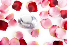 Free Pile Of Round Pebbles With Rose Petals Royalty Free Stock Photography - 5457917