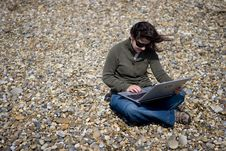 Free Young Woman With Laptop Computer In Beach Stock Photos - 5458003
