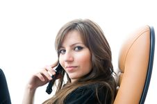 Free Beautiful Businesswoman With Phone Looking At Came Royalty Free Stock Image - 5459536
