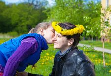 Daughter Kisses Mom In The Park Royalty Free Stock Images