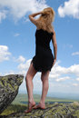 Free Woman In The Black Dress On Rock Stock Photos - 5460123